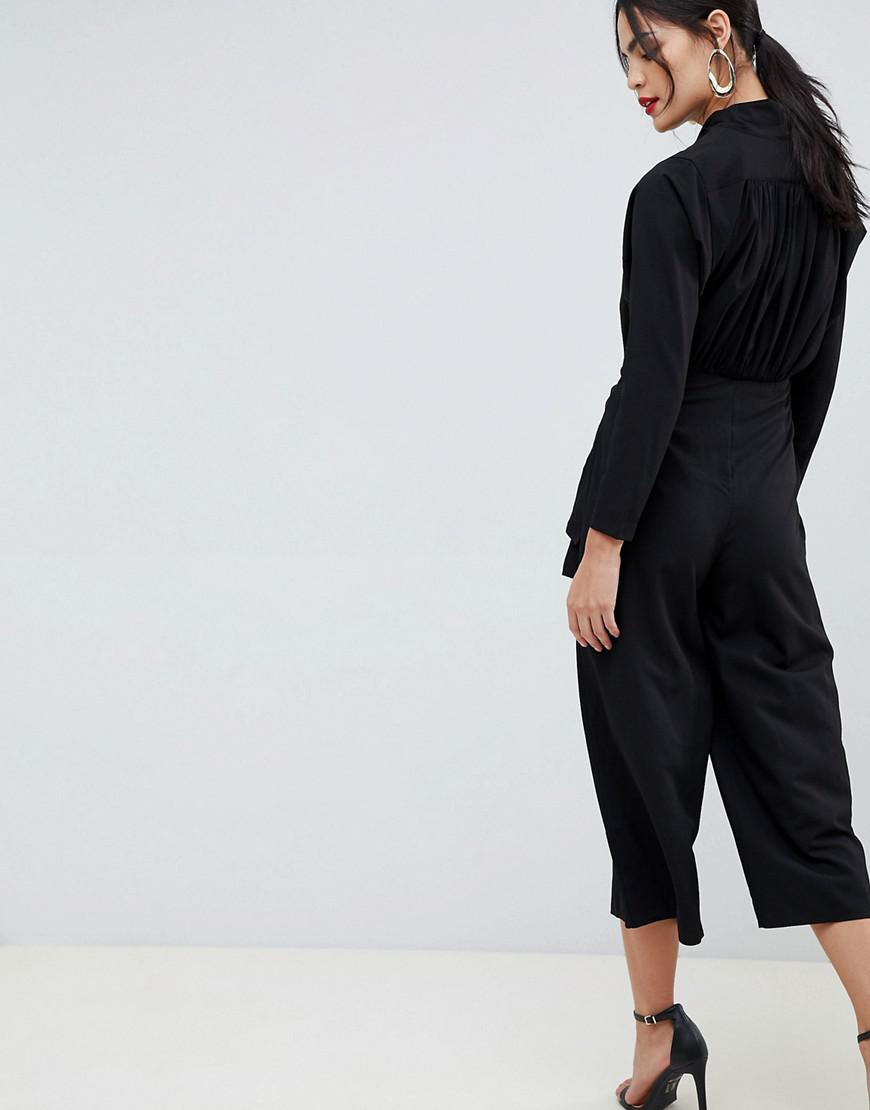 6a2e35210b6 Lyst - Asos Design Plunge Neck Jumpsuit With Tie Waist And Cullotte Leg in  Black