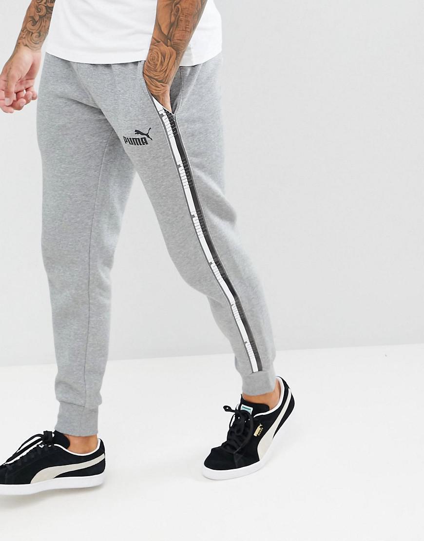 Pantalon de jogging avec bandes contrastantes sur les cts PUMA ...