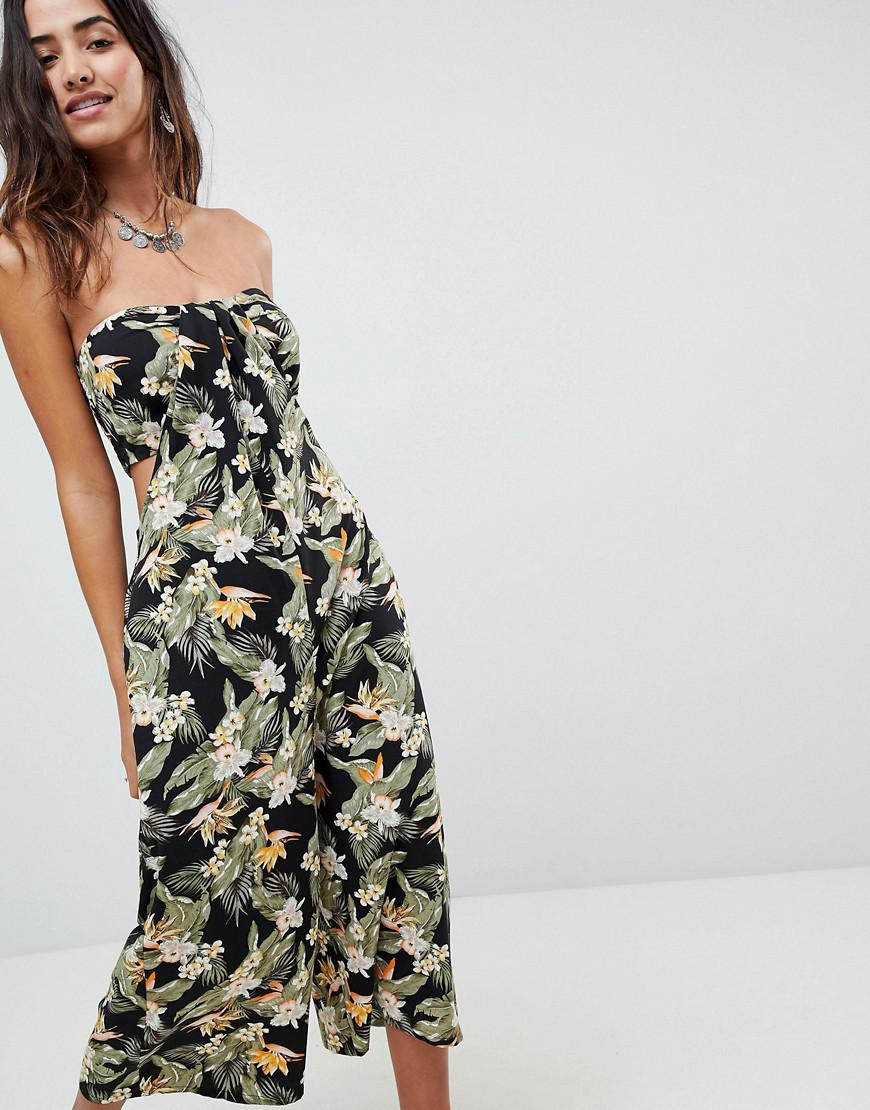 ae45cdd933d Lyst - ASOS Bandeau Jumpsuit With Cut Out And Drape Detail In Print