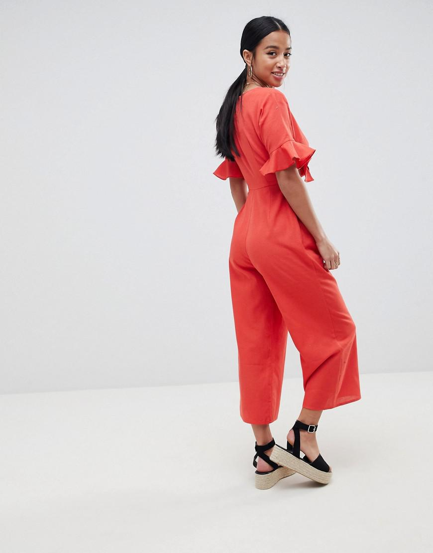 9a2d697a121 Lyst - ASOS Asos Design Petite Tea Jumpsuit With Cut Out And Tie Detail In  Linen in Black