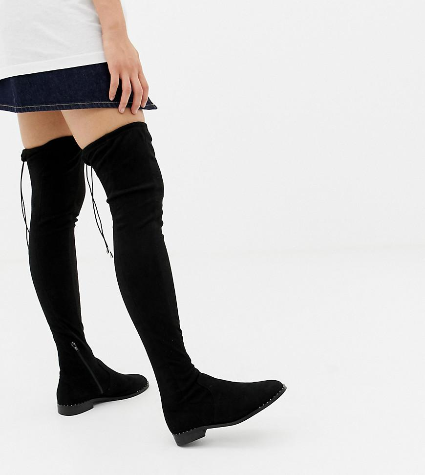 5c48e514412 Lyst - ASOS Kaska Flat Studded Thigh High Boots in Black - Save 16%