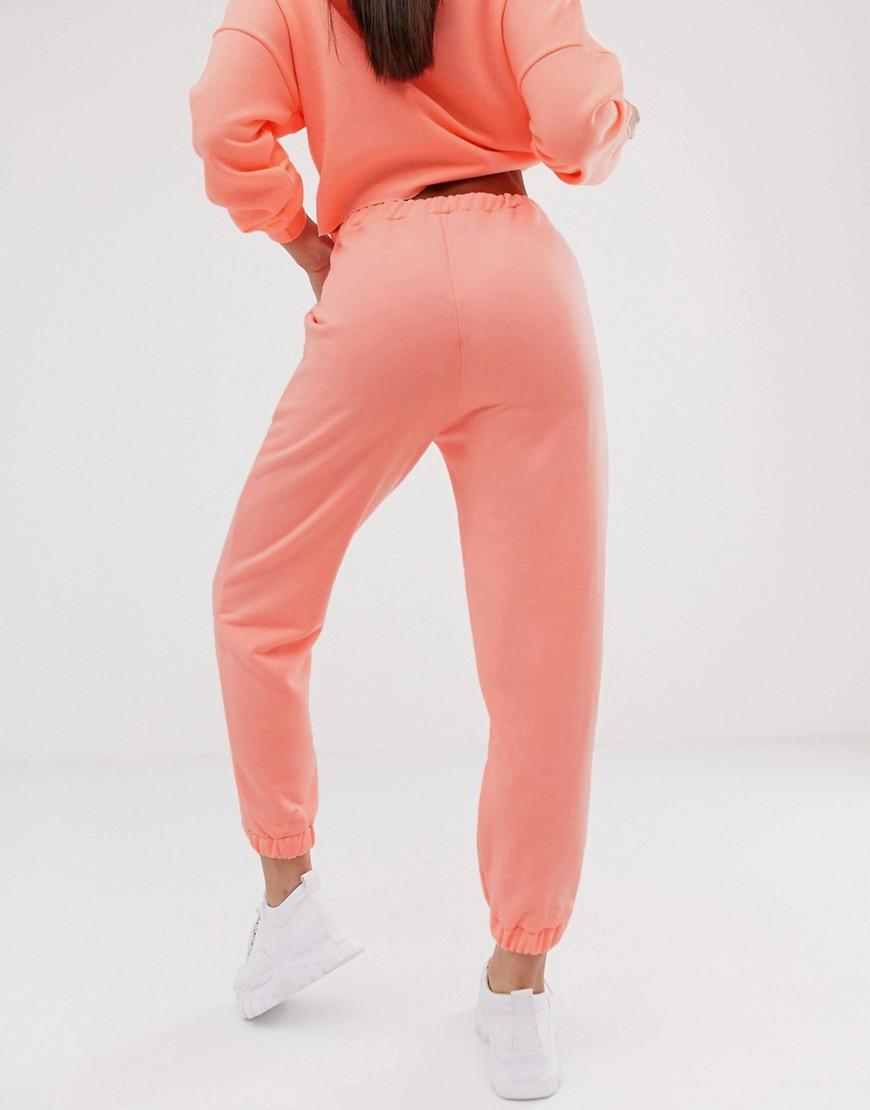 32bfe0a55ae5 Joggers extragrandes de conjunto en neón de mujer de color rosa