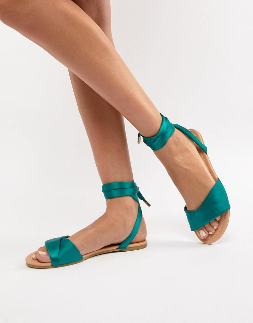 98f2693fa789 Lyst - ASOS Flashing Tie Leg Flat Sandals in Green