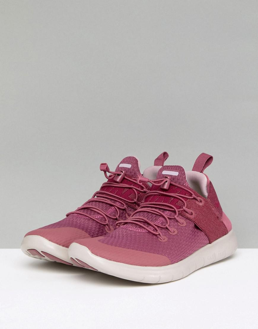 b0006bb60ec8 Nike Running Free Run Commuter Trainers In Pink in Pink - Lyst