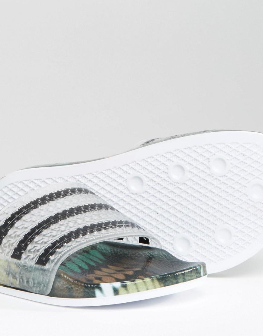 45e5ff3b877b Lyst - adidas Originals Originals X Rita Ora Slider Flat Sandals in Black