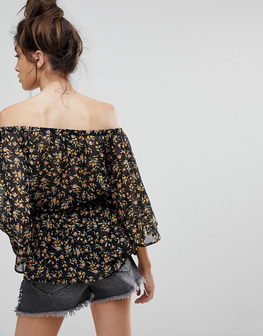 24a5feabaa0b reclaimed-vintage-Black-Inspired-Off-Shoulder-Top-With-Studded-Belt.jpeg
