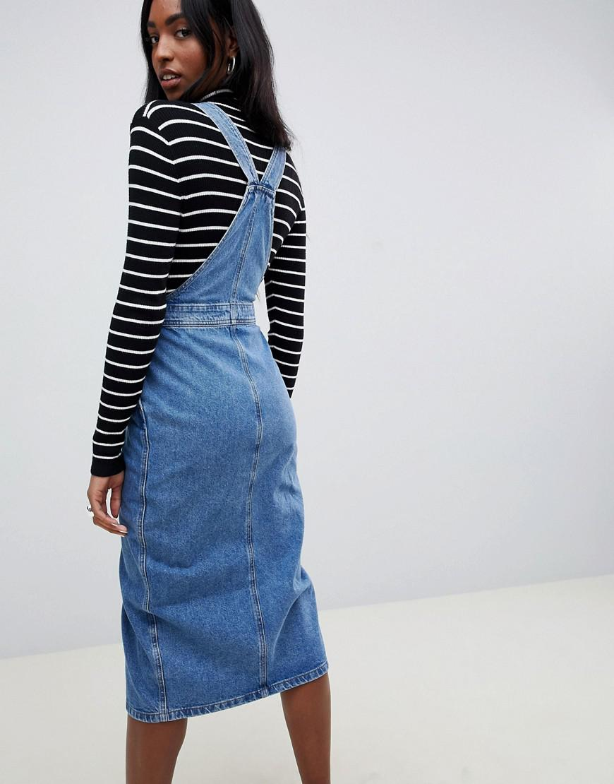 ce708ca0bc ASOS Asos Design Tall Denim Midi Dungaree Dress In Mid Wash Blue in Blue -  Lyst