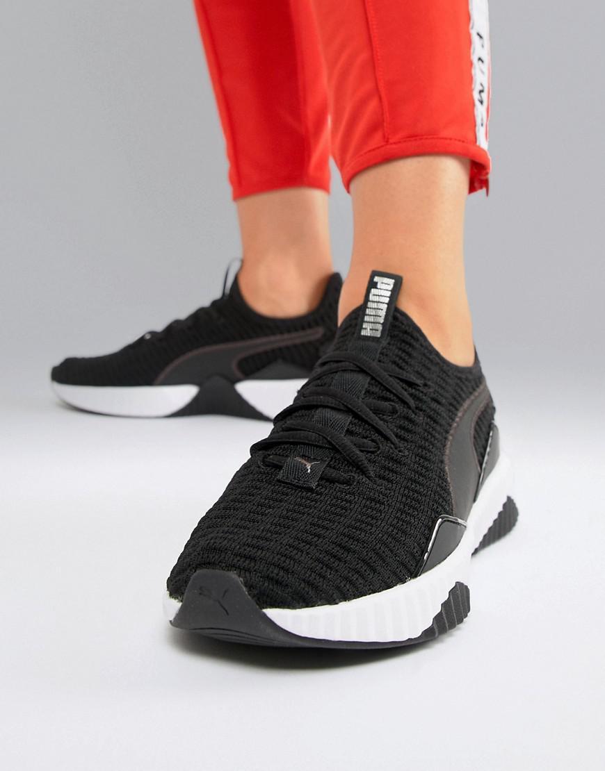 59ab9e3ae1b291 Lyst - PUMA Training Defy Sneakers In Black in Black