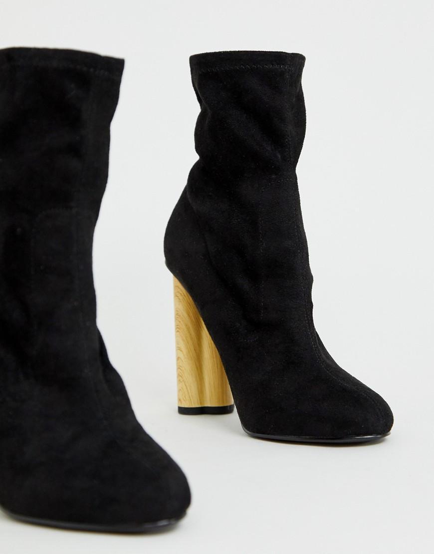 6de8beef346 Lyst - ASOS Eliza Wooden Heeled Sock Boots in Black