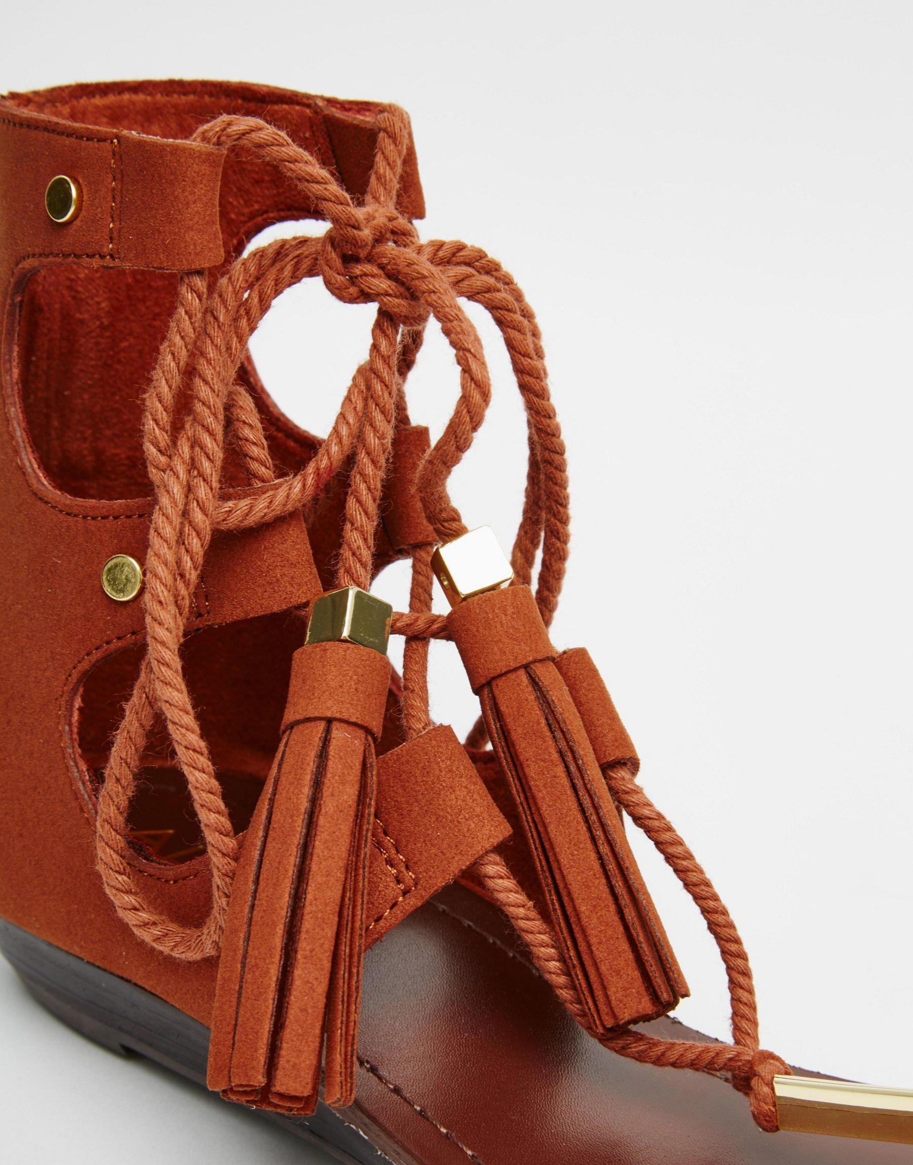 e196e02b415e Lyst - ALDO Jakki Rust Gladiator Tassel Flat Sandals in Brown