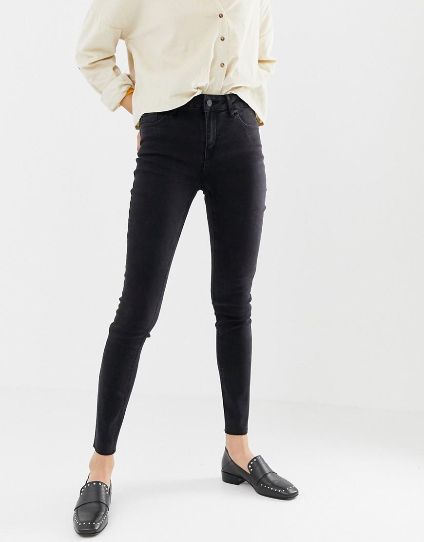6cba5588e9e Lyst - ONLY Pearl Mid Rise Raw Hem Skinny Jeans in Black