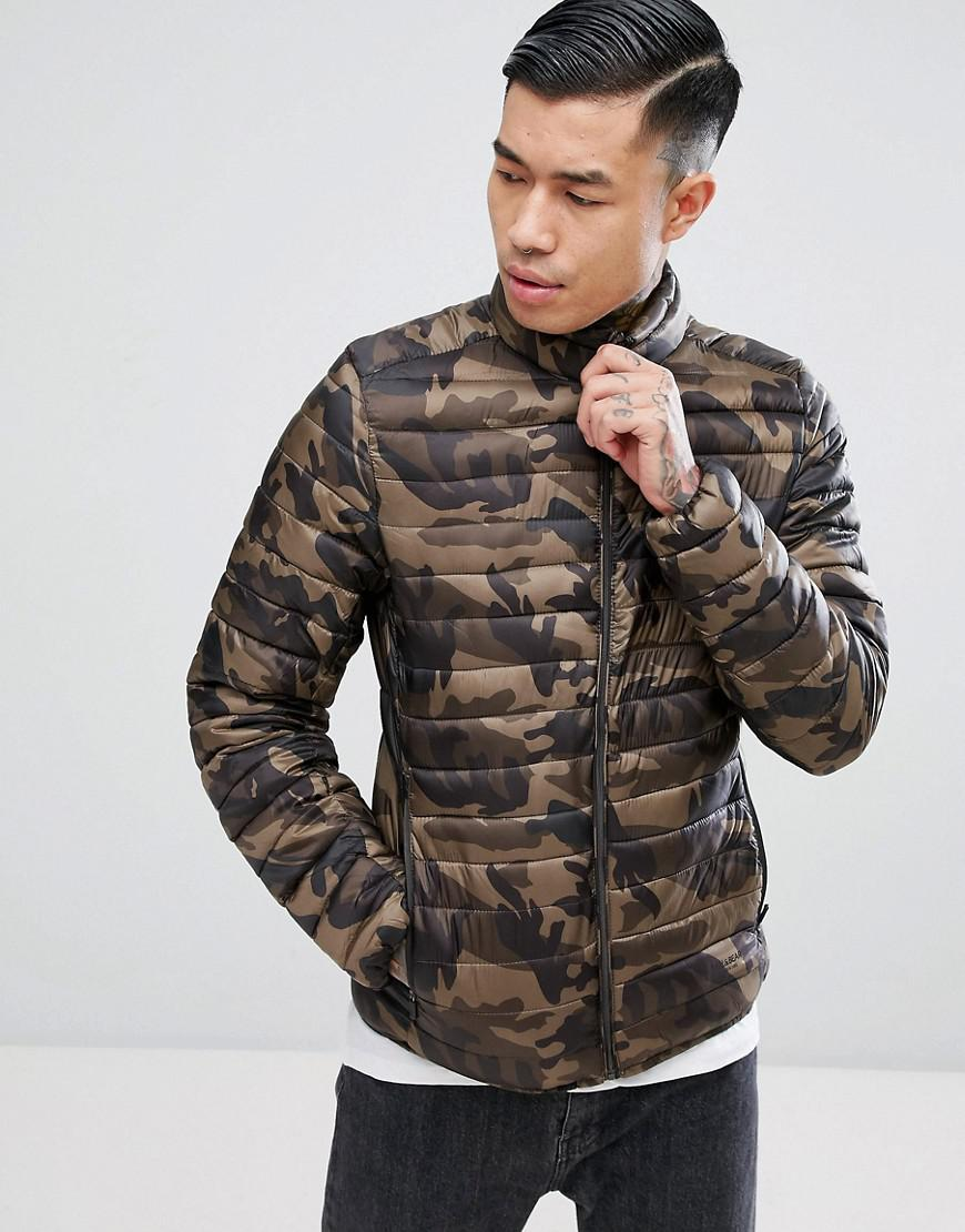 lyst pull bear quilted jacket in light khaki in green. Black Bedroom Furniture Sets. Home Design Ideas
