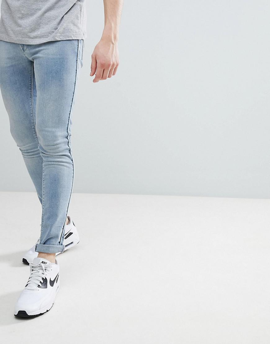 2649d941924 Lyst - ASOS Extreme Super Skinny Jeans In Light Wash Blue With ...