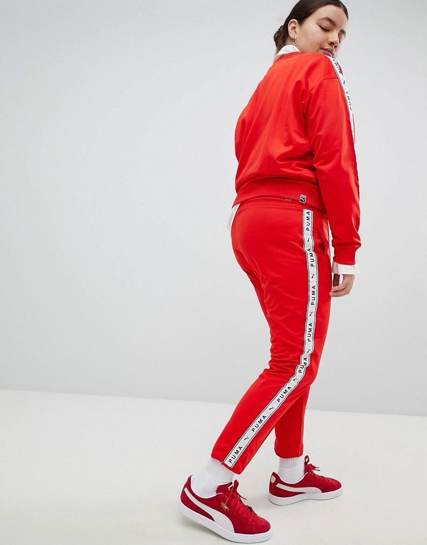 c80f4e5a57 PUMA Exclusive To Asos Taped Side Stripe Track Pants In Red in Red - Save  26% - Lyst
