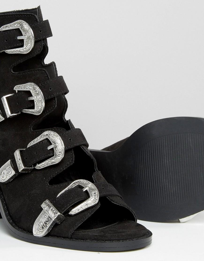ee0b3c409bae Lyst - ASOS Tarvo Western Heeled Sandals in Black