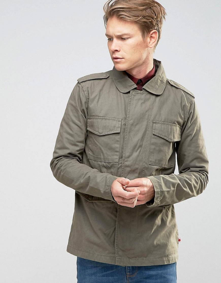 Try wearing a military jacket buttoned up with a decorative belt around the outside. With a Dress 7 of 11 Pair your olive military jacket with a dress in fall colors.