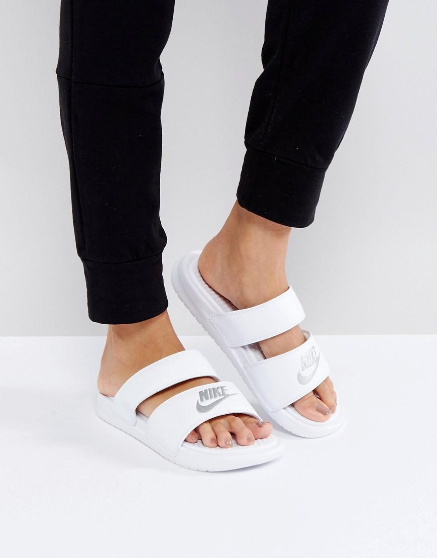 nike benassi duo logo slider sandals in white in white lyst. Black Bedroom Furniture Sets. Home Design Ideas