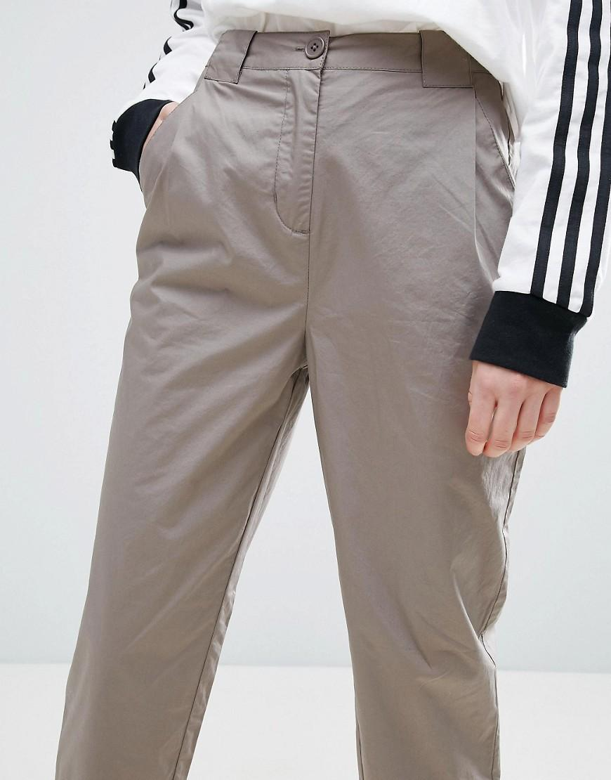 high waisted chino pants. colors. high waisted chino pants. faux leather pants. animal print jeans. plaid paperbag pants. colors. pants with side stripes. pants with darts. palazzo pants. wide leg checkered pant. camouflage paperbag pants. velveteen pants. colors. jacquard pants with buckle. colors. jacquard pants with buckle.