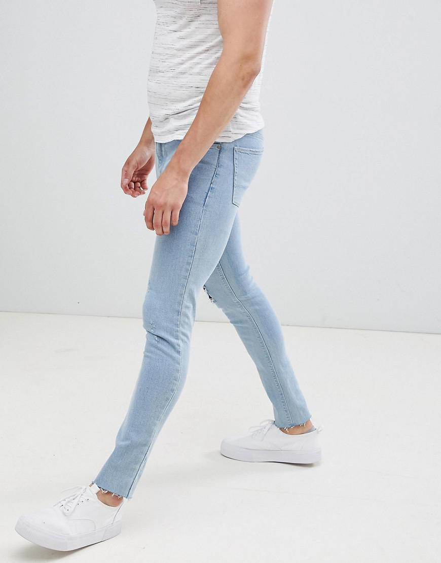ASOS Super Skinny Jeans In Bleach Wash With Rip And Repair in Blue for Men