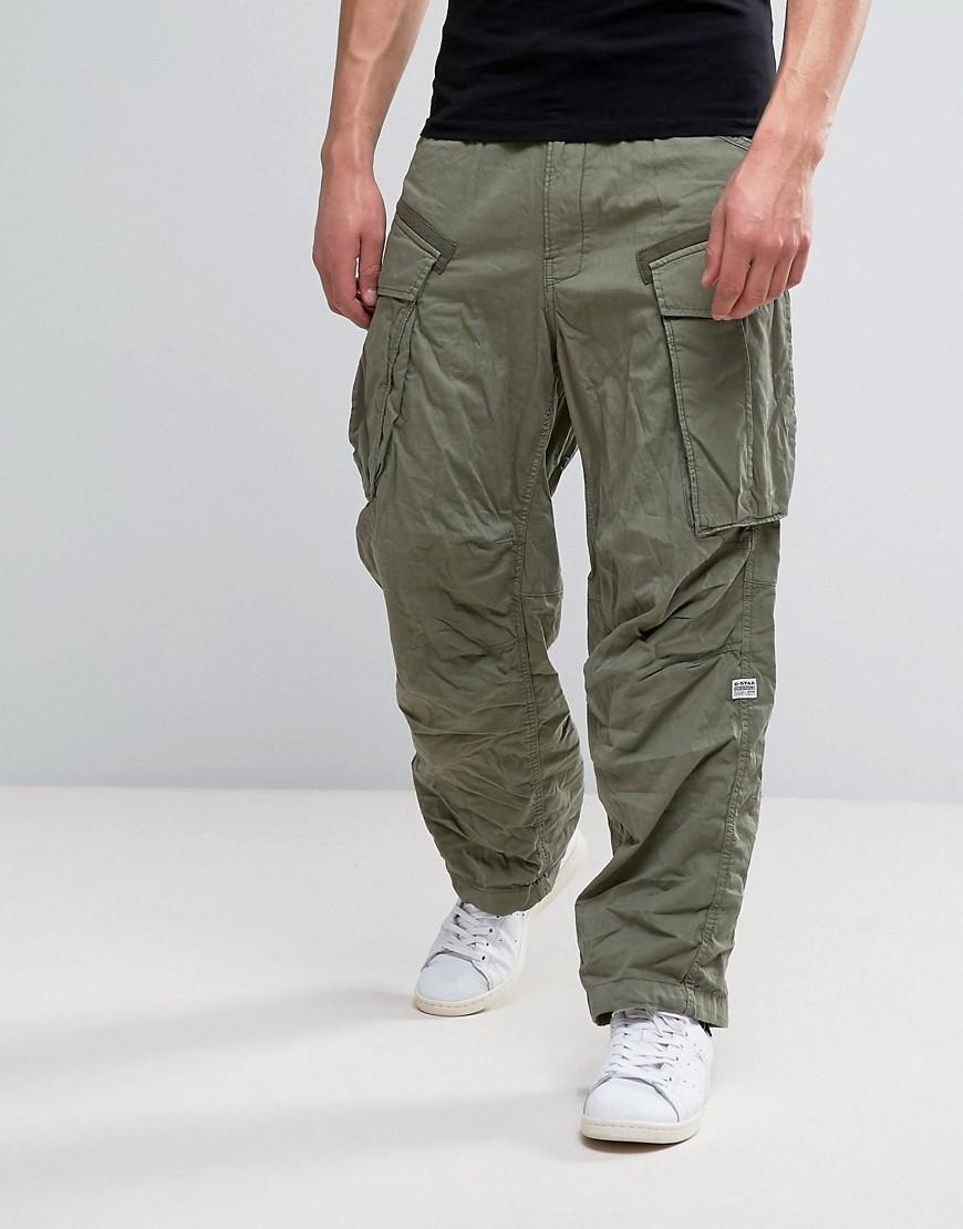 Superdry men's ripstop parachute pants. Made from reinforced ripstop fabric, these parachute pants feature six front pockets, two rear pockets and a zip fly fastening. The pants are finished with various applique Superdry branded badges and branded buttons.