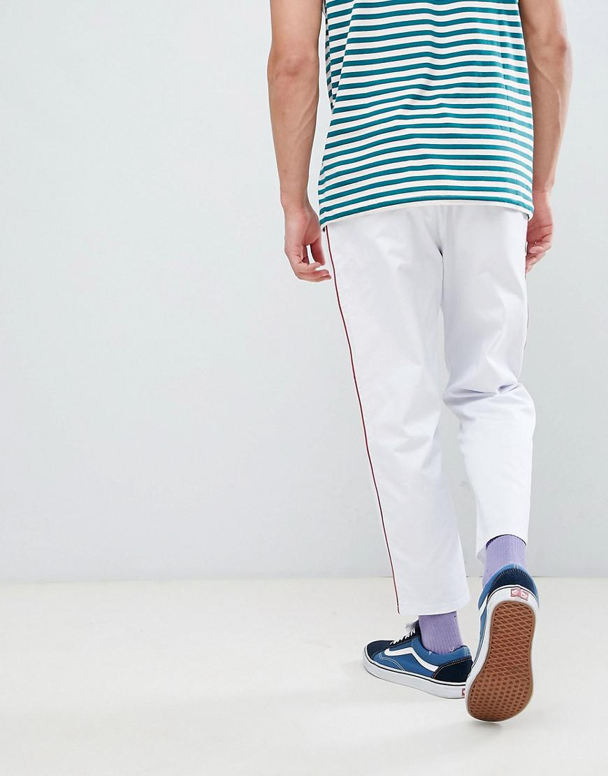 ASOS Relaxed Cropped Trousers In White With Red Side Piping for Men
