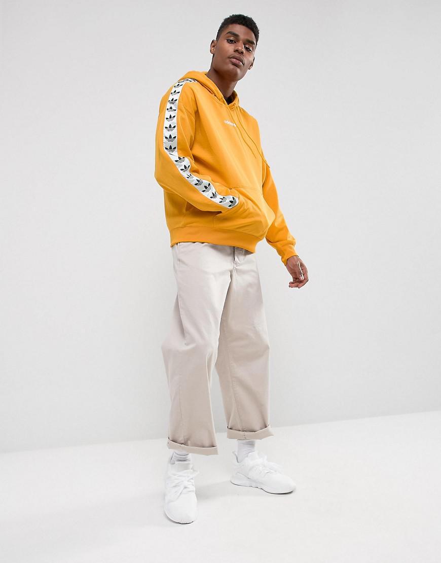 Adicolor Tnt Tape Hoodie In Yellow Az8127
