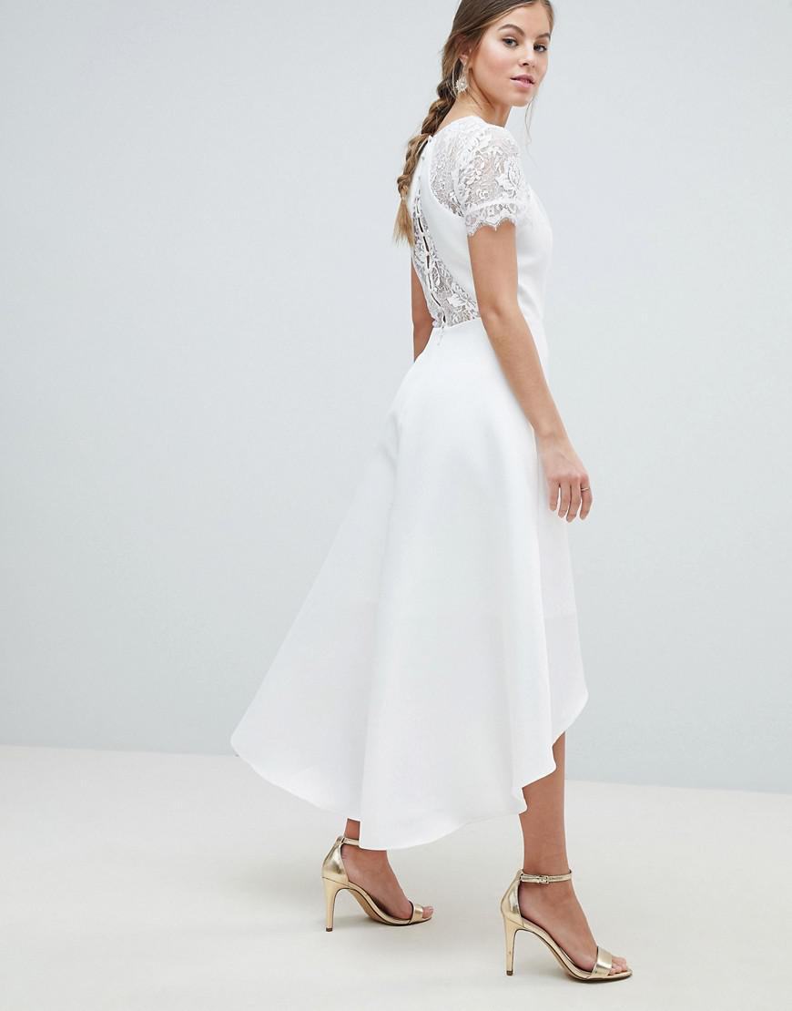 e6d06ecb10c Chi Chi London White Floral Lace Neckline Short Sleeve High-low Dress in  White - Lyst