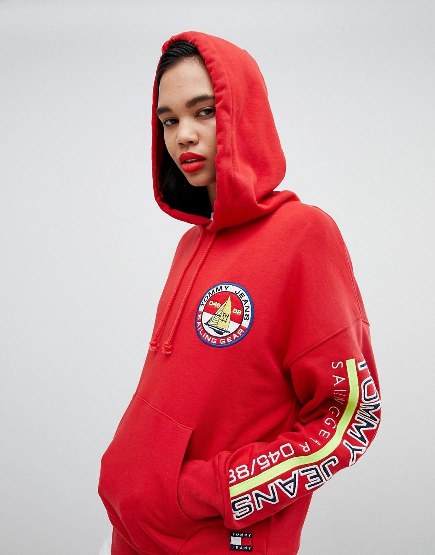 25a88fc2adb53a Tommy Hilfiger. Women s Red 90s Capsule 5.0 Sailing Hoodie With Sleeve Logo