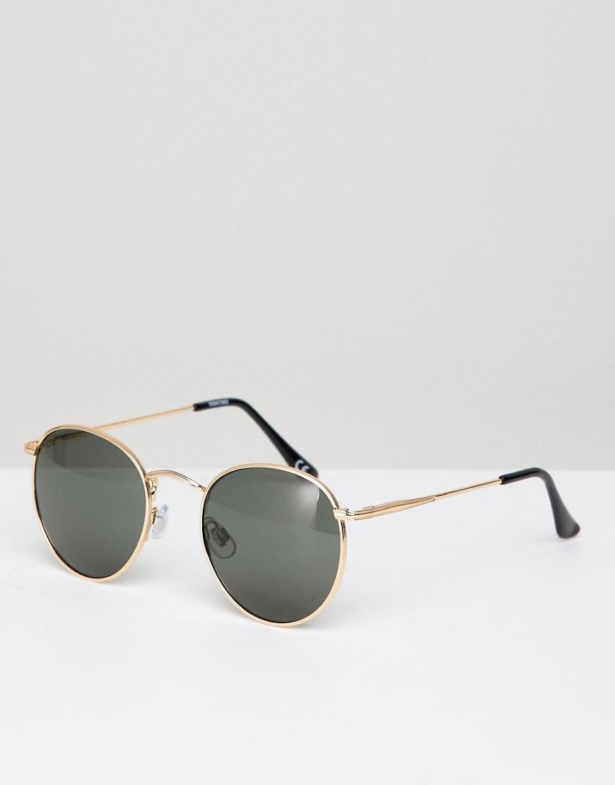 3b51d94fa7 Gafas de sol redondas en dorado con detalle de puente para la nariz ...