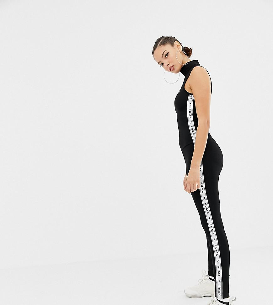 6af2c90c4522 Puma Exclusive Black Tapping High Neck Jumpsuit in Black - Lyst