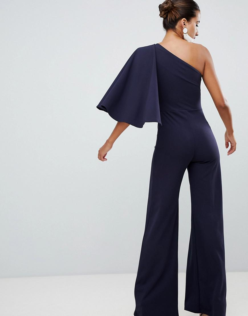 bd7e65aa10b4 Club L One Shoulder Jumpsuit With Cape Sleeve in Blue - Lyst
