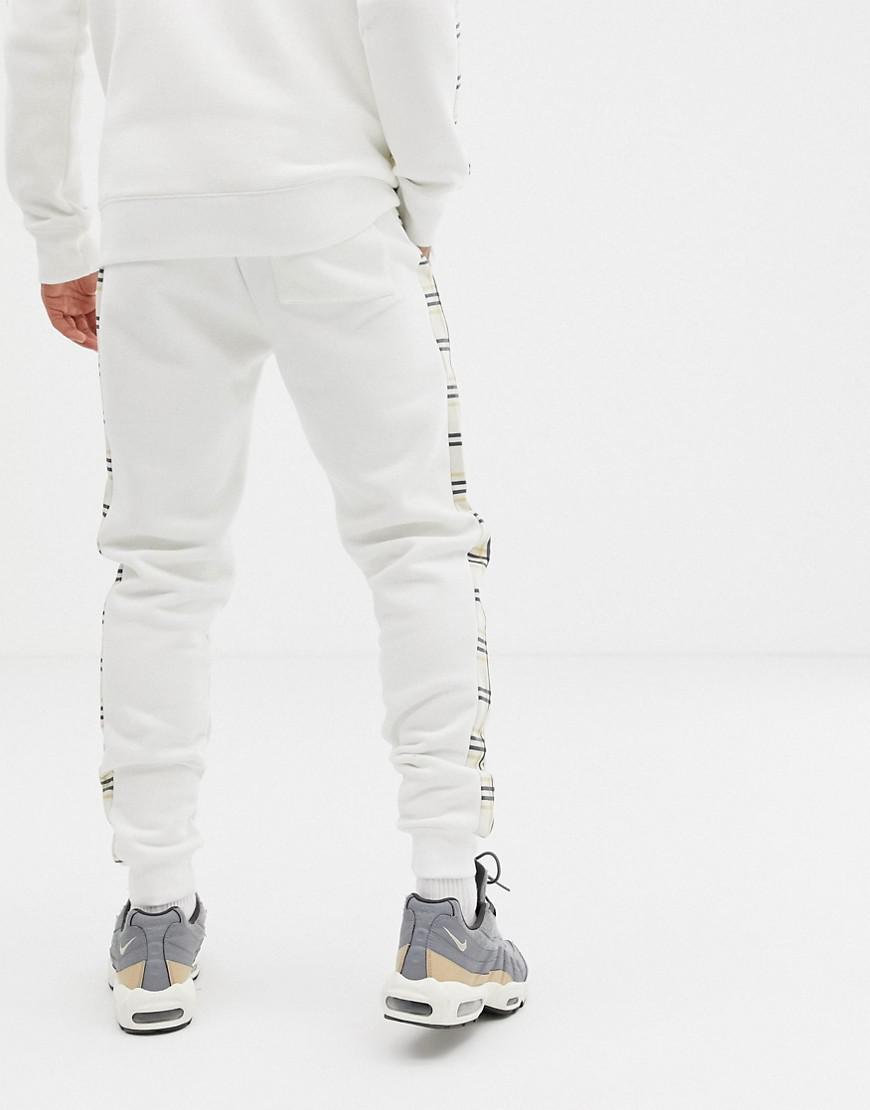 Criminal Damage Katoen Skinny joggingbroek In Wit Met Geruite Zijstreep in het Wit voor heren