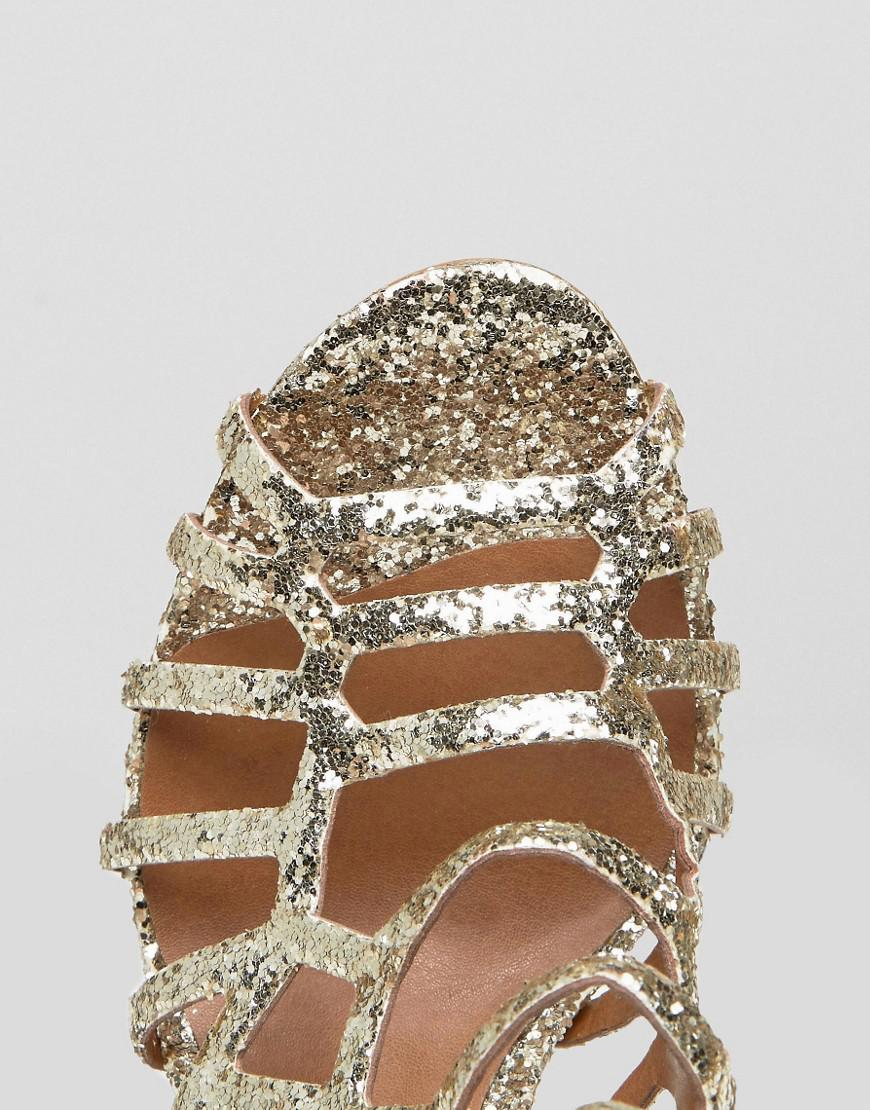 7dc17c971ac Steve Madden Metallic Slithur Gold Glitter Caged Heeled Sandals