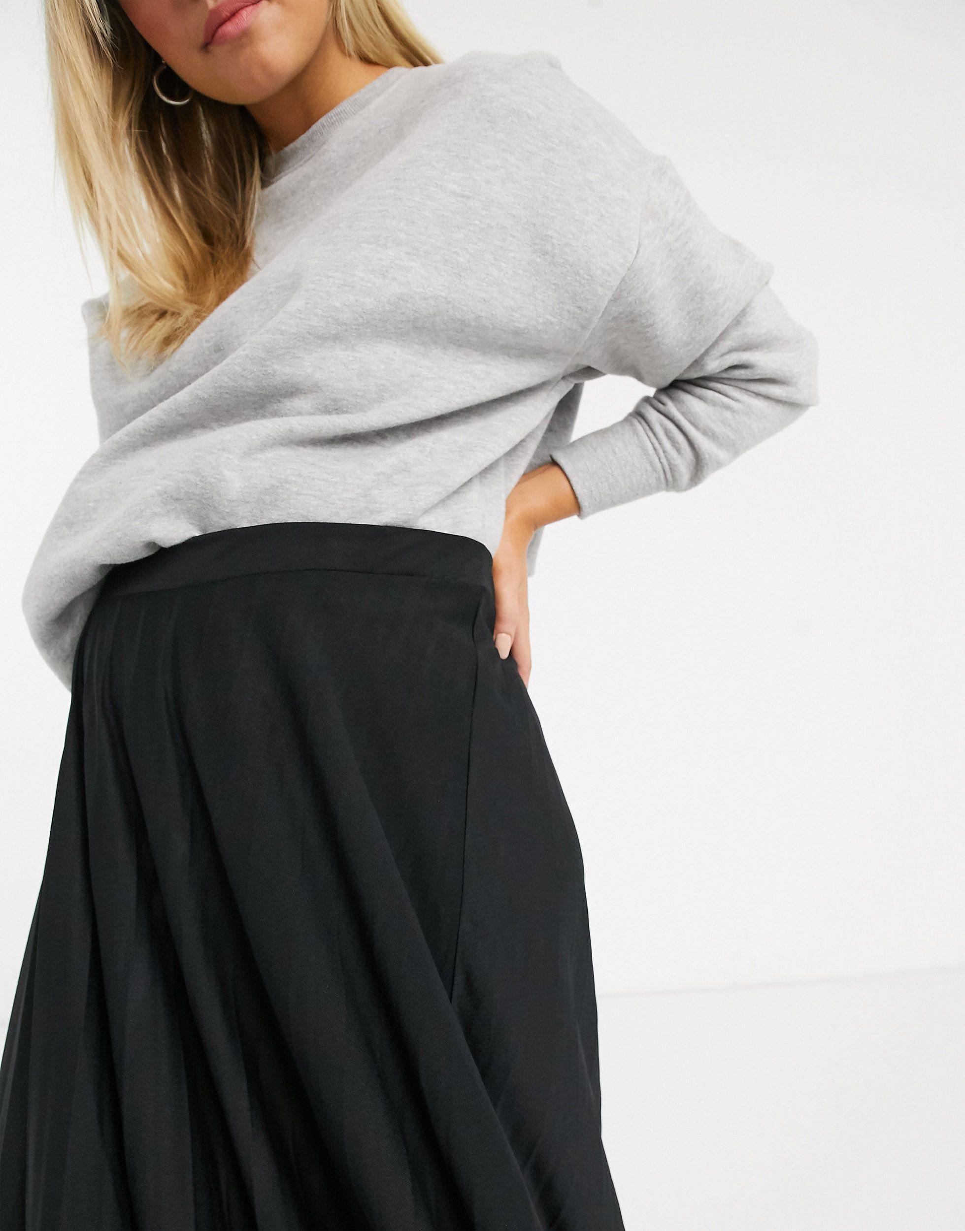 ASOS DESIGN Maternity - Jupe mi-longue plissée passant sous le ventre Synthétique ASOS en coloris Noir