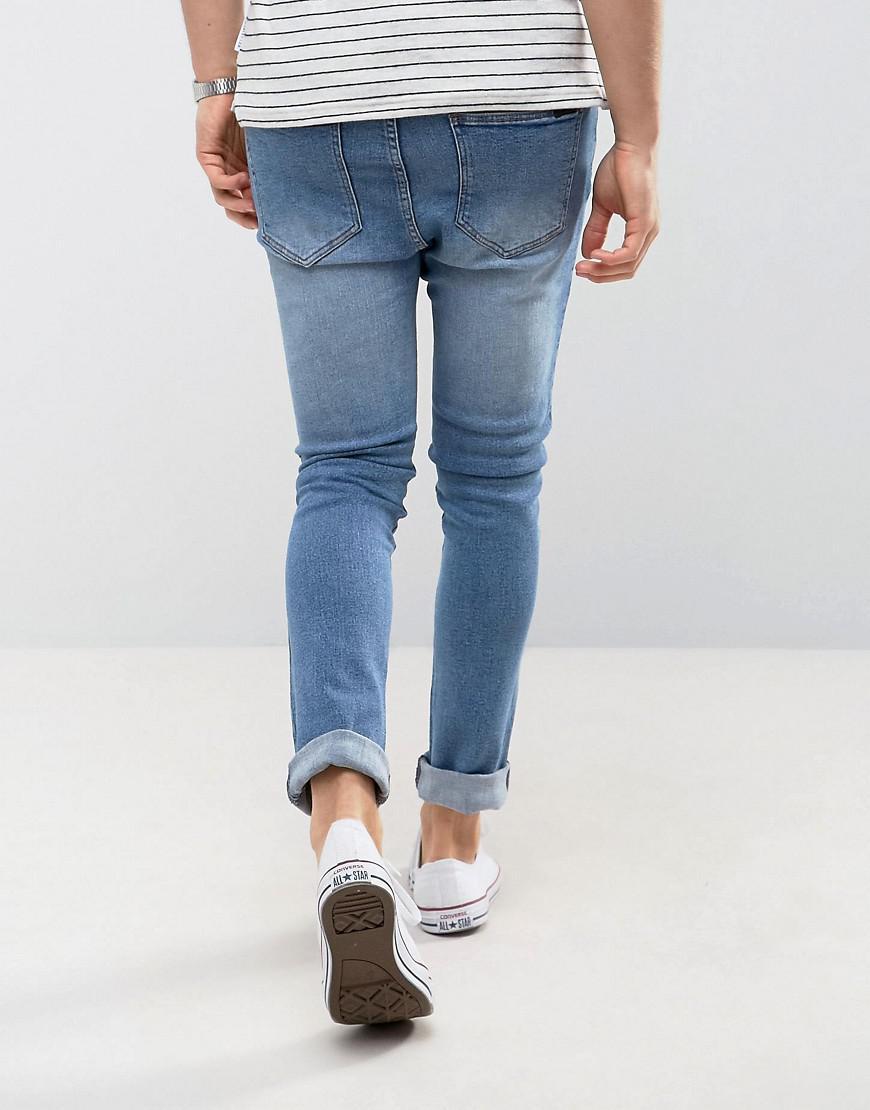 Dr. Denim Denim Jeans Leon Slim Tapered Drop Crotch Light Stone Wash in Blue for Men
