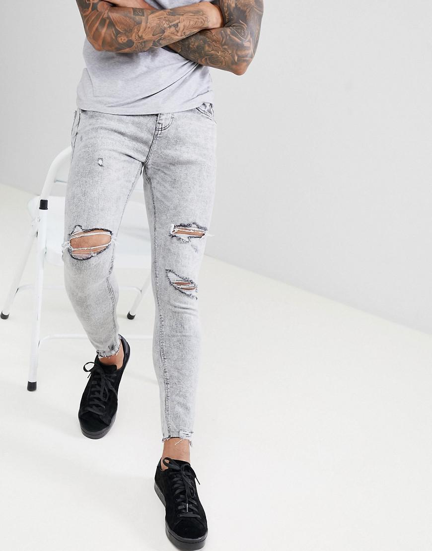 e4e043917 Jean super skinny avec dchirures aux genoux Bershka pour homme en coloris  Gray