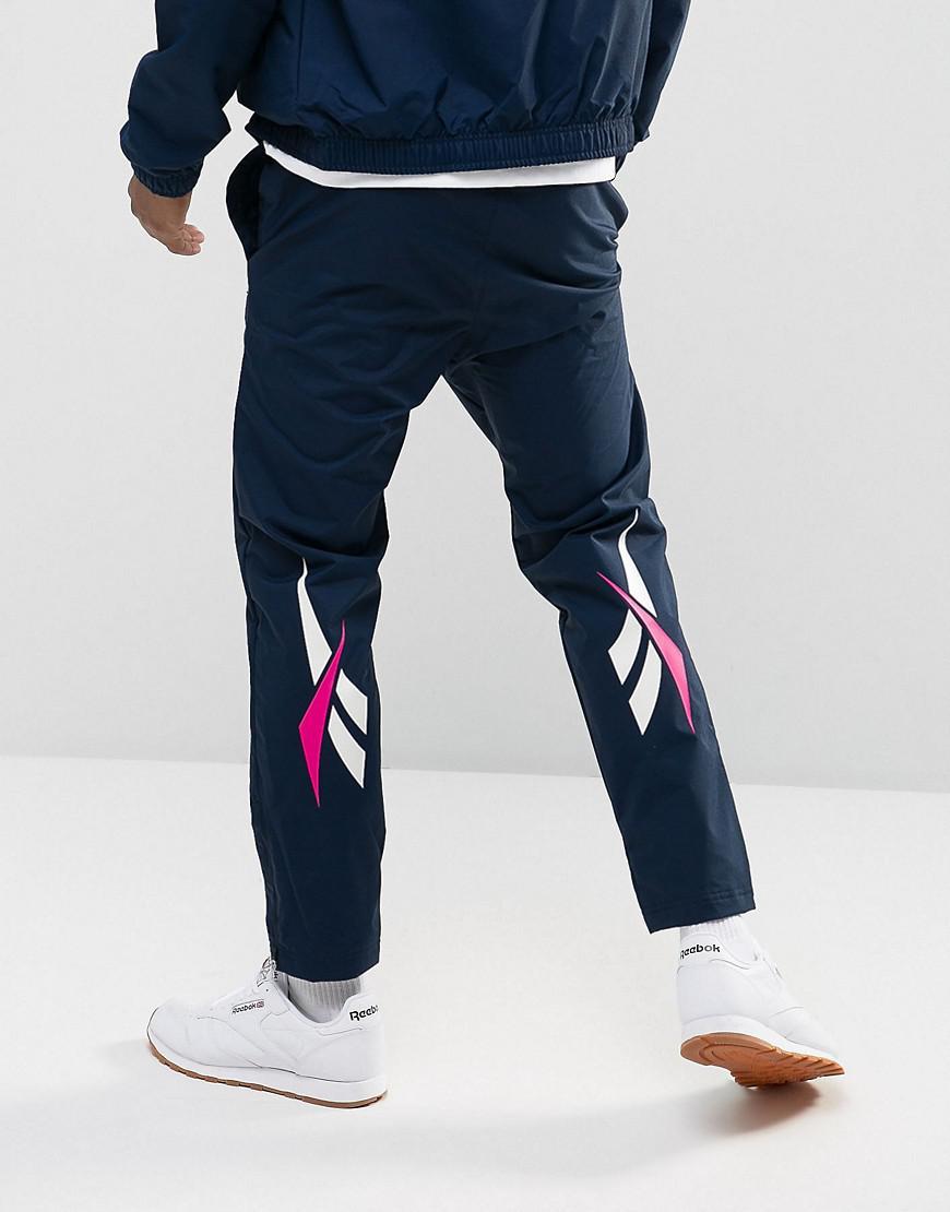 Reebok Classics all over vector jogging bottoms in navy