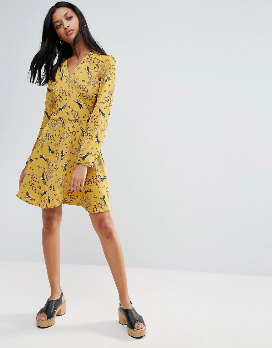 Liquorish Synthetic Swallow Print Wrap Front Long Sleeve Dress in Yellow