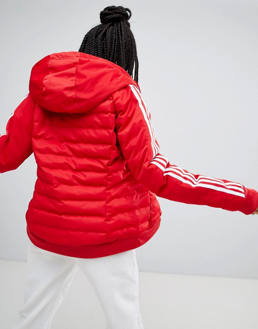 site réputé eba3e 0aa63 Doudoune trois bandes Adidas Originals en coloris Red