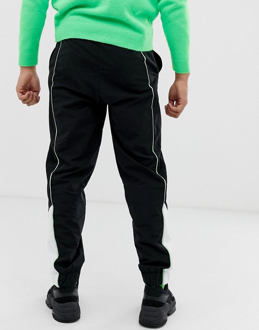 Collusion Denim Joggingbroek Met Neon Biezen in het Zwart voor heren