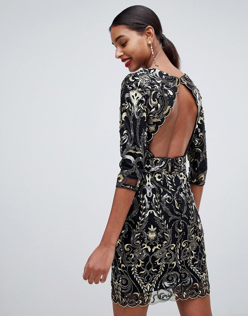 Lyst - TFNC London Patterned Sequin Mini Bodycon Dress With Scallop Open  Back In Black in Black e3771e073