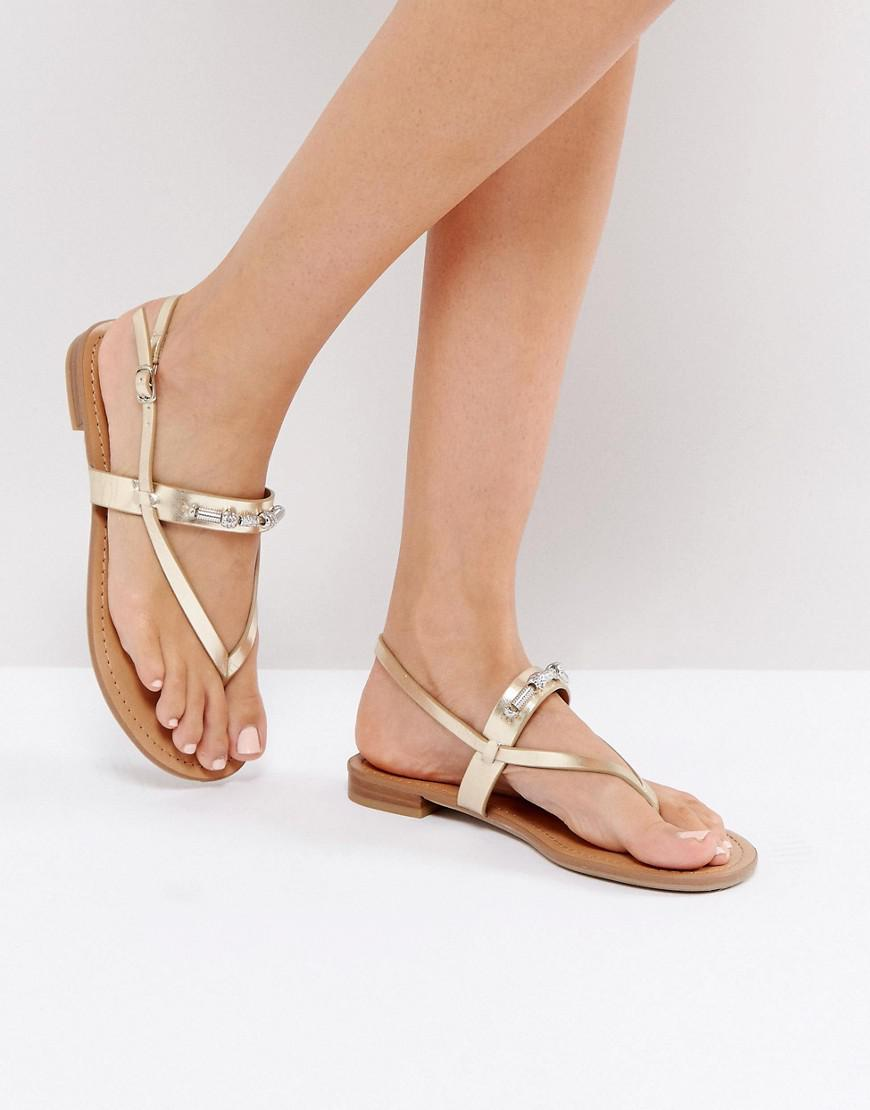 06ce3fd8621 Call It Spring Taketa Gold Embellished Flat Sandals in Metallic - Lyst