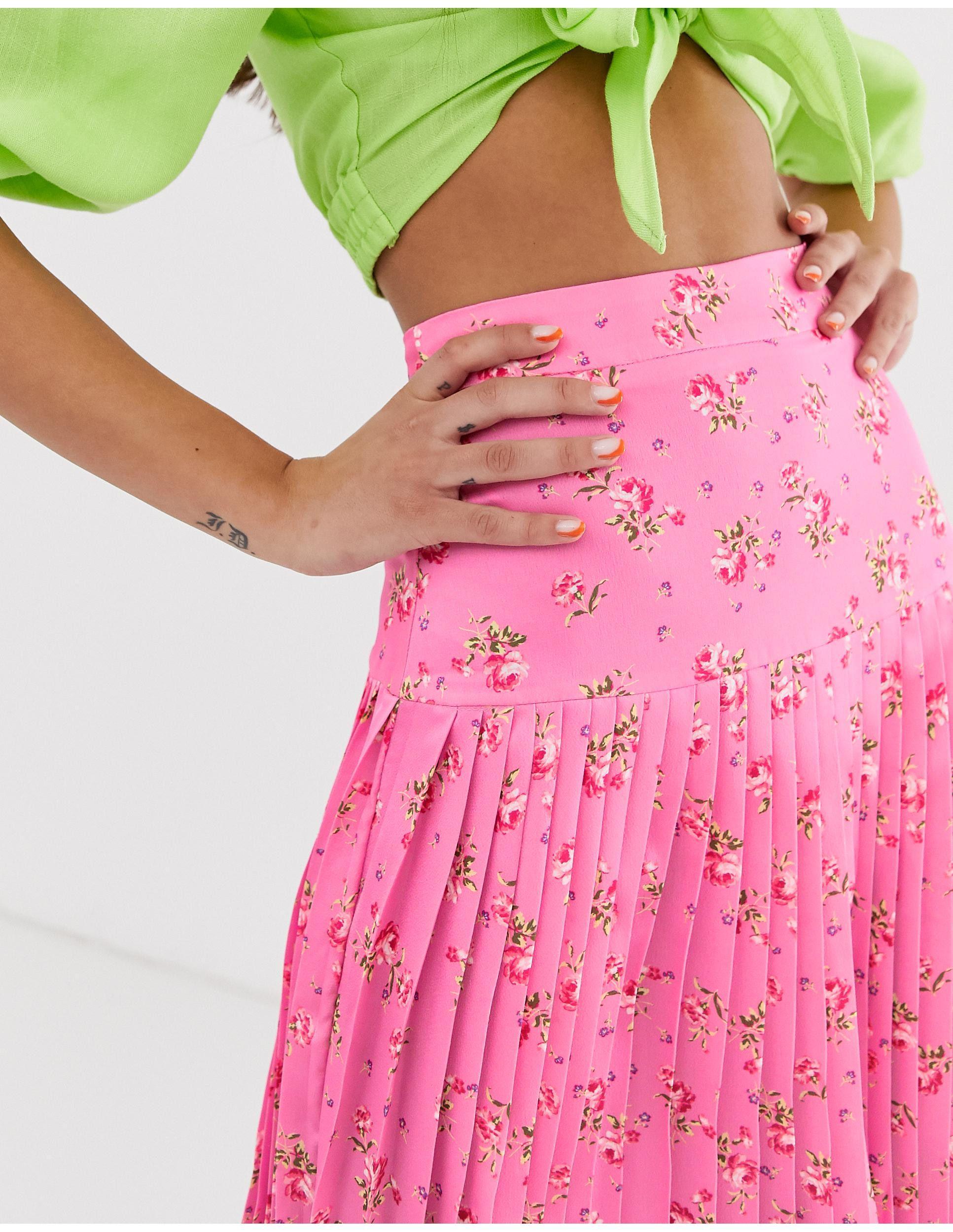 Jupe mi-longue plissée - fleuri Synthétique Never Fully Dressed en coloris Rose