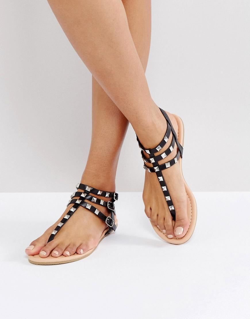 05c14e778511e Lyst - ASOS Fabienne Studded Flat Sandals in Black