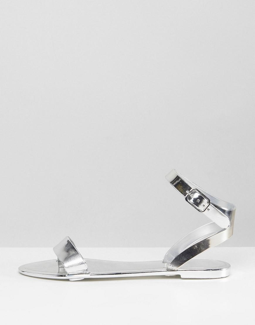 68da773946c Lyst - ASOS Design Felina Jelly Flat Sandals in Metallic
