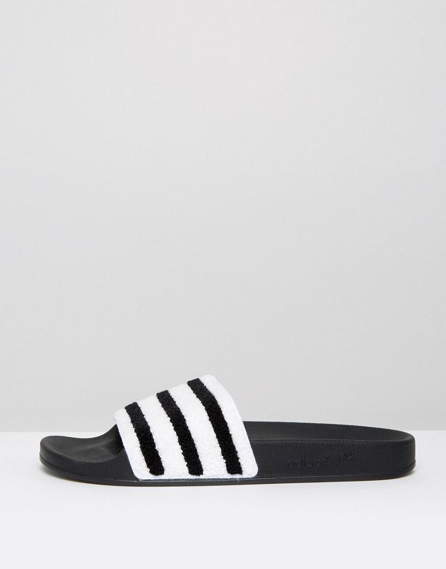 24d0e8bcaad9f8 adidas Originals Adilette Stripe Slides in Black for Men - Save 37% - Lyst