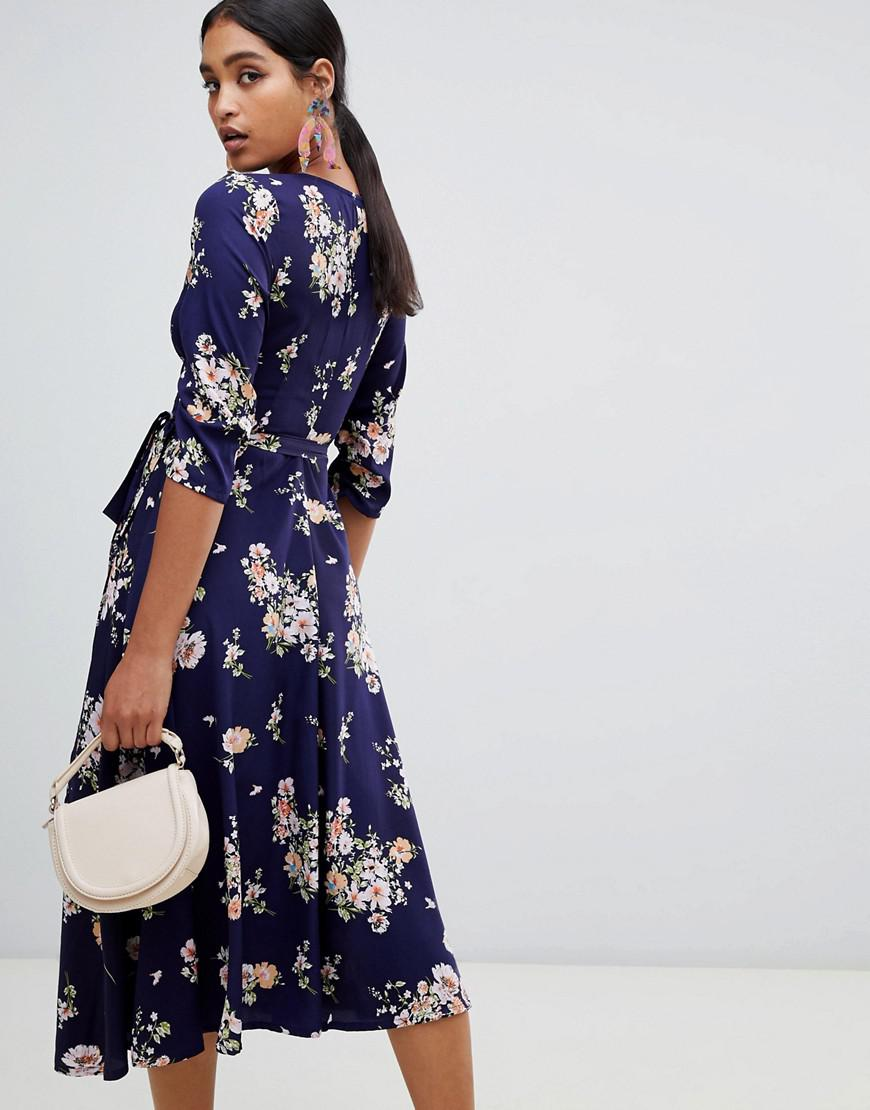 9b874058ca015 Liquorish Floral Print Wrap Midi Dress in Blue - Lyst