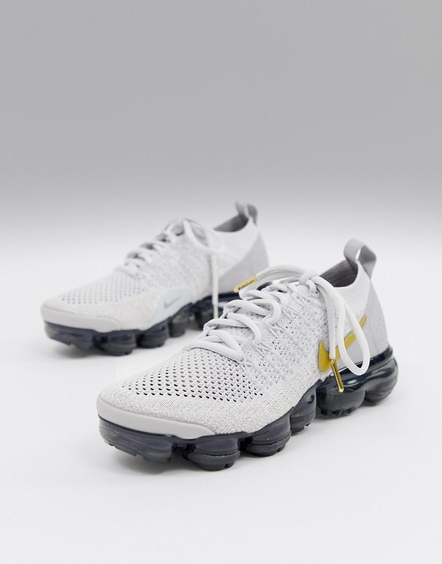 info for 19077 77eb8 Nike Vapormax Flyknit Trainers In White And Gold - Lyst