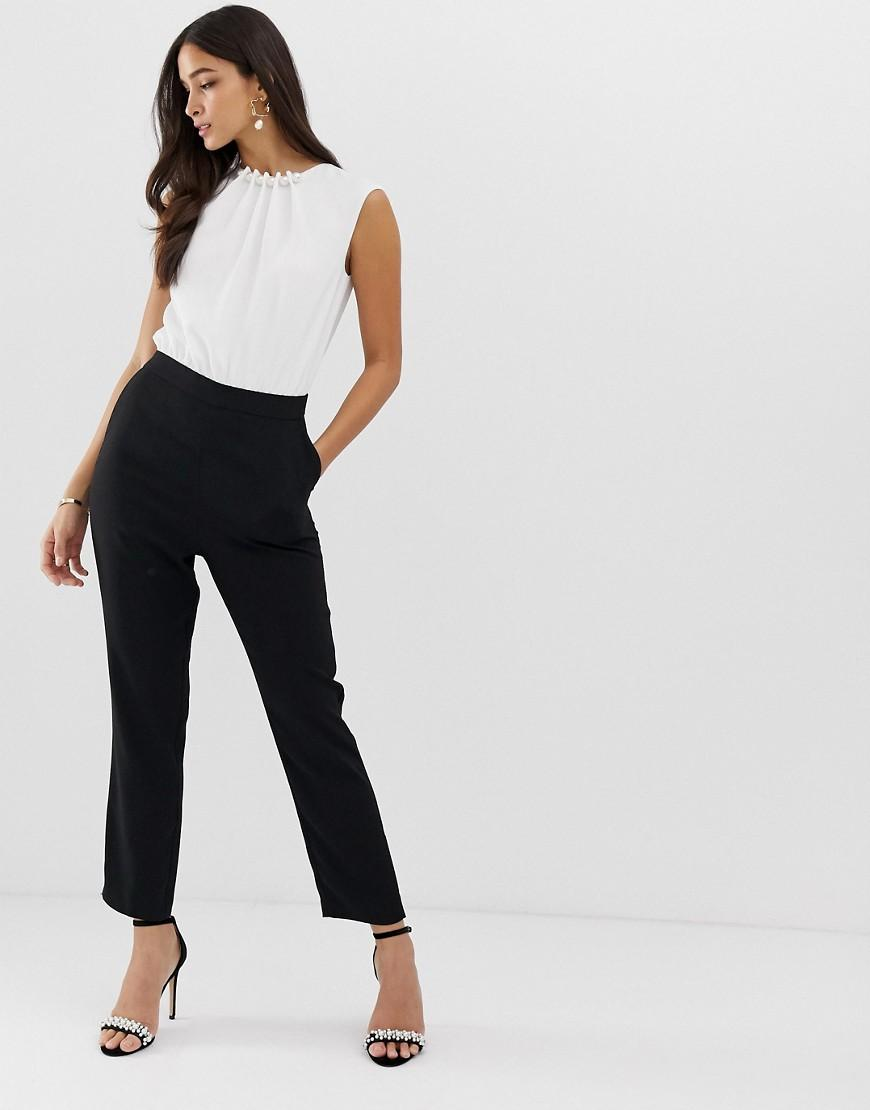 58274ad4892 Ted Baker Roziee Pearl Neck Jumpsuit in Black - Lyst