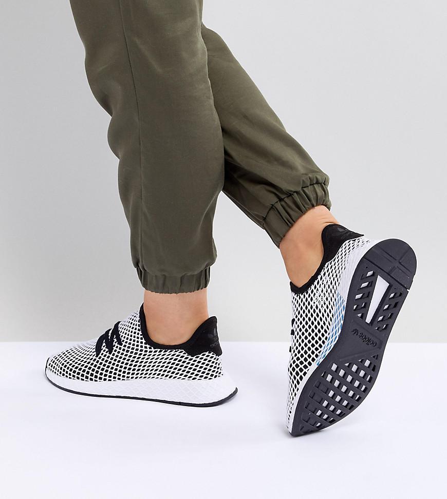 lyst adidas originali deerupt runner formatori in nero e grigio